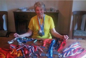 Sandra, seen her wearing her 4 medals from 2014, sitting in front of 42 medals won between 2006-2013!